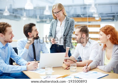 Business team approving his colleague�¢??s idea about company�¢??s development