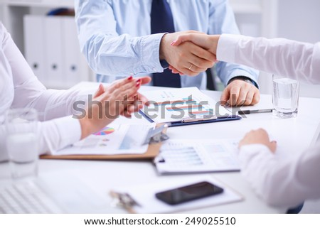 Business team are showing unity with their hands - stock photo