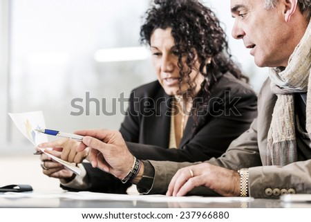Business team at a meeting. They are analyzing good statistic of their agency. - stock photo