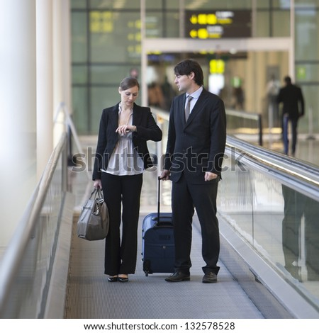 business team at airport - stock photo