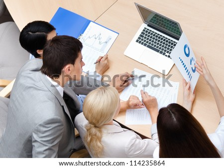 Business team at the meeting discuss current issues at the modern office building. Cooperation process - stock photo
