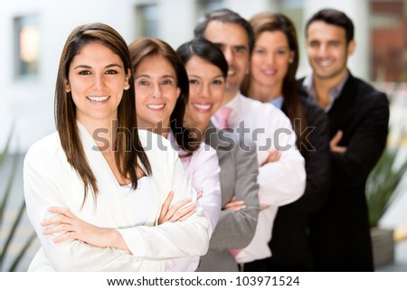 Business team at the office looking happy - stock photo