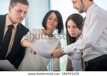 Business team at workplace in modern office environment