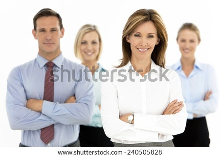 Business team behind female leader - stock photo