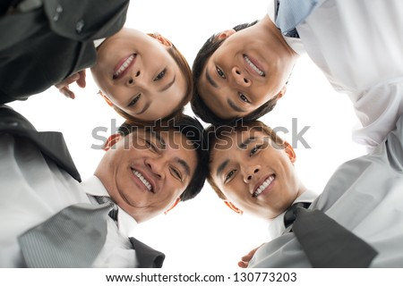 Business team below against a white background