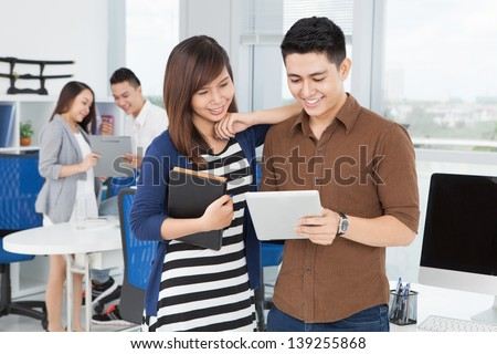 Business team brainstorming together on the foreground - stock photo