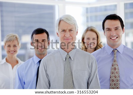 Business Team - Business people standing in a row - stock photo