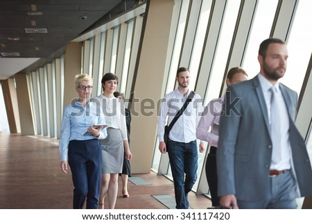 business team, businesspeople  group walking at modern bright office interior