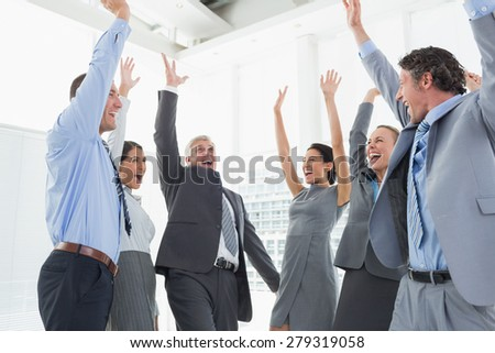 Business team celebrating a good job in the office - stock photo