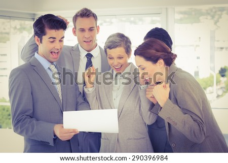 Business team celebrating a new contract in the office - stock photo