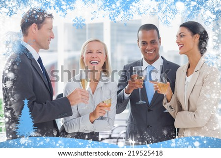 Business team celebrating with champagne against snow - stock photo