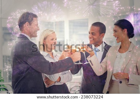 Business team celebrating with champagne and toasting against colourful fireworks exploding on black background - stock photo