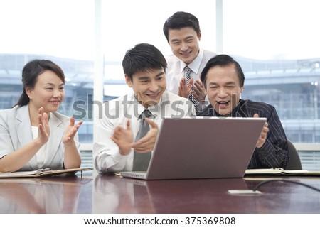 Business Team Cheering - stock photo