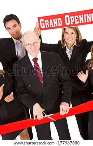 Business: Team Cheers For Grand Opening Ribbon Cutting - stock photo