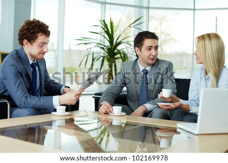 Business team communicating during break - stock photo