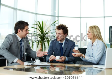 Business team communicating during break - stock photo