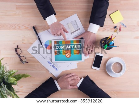 Business team concept - CONTACT US - stock photo