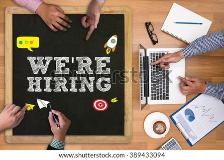 Business Team Concept: WE'RE HIRING - stock photo