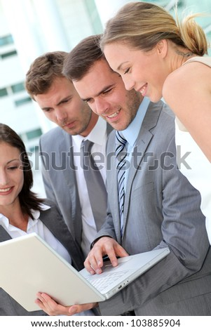 Business team consulting program on laptop - stock photo