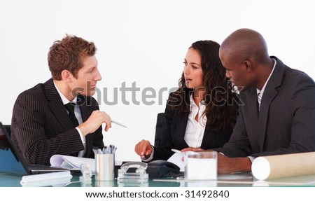 Business team conversing in a business meeting - stock photo