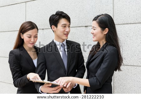 Business team discuss about the information on file