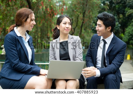 Business team discuss on laptop computer