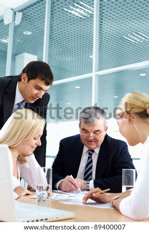 Business team discussing important matters - stock photo