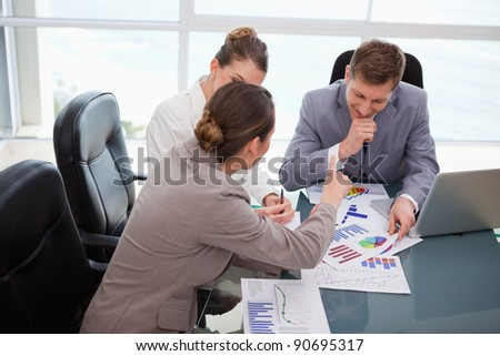 Business team discussing over market research results - stock photo