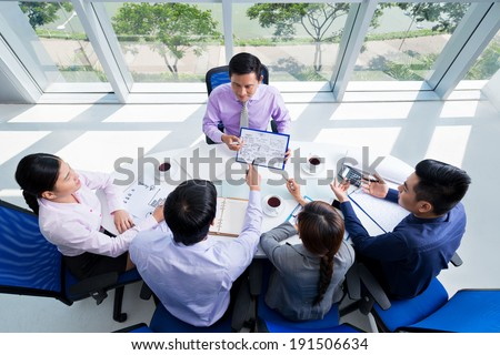 Business team discussing project - stock photo