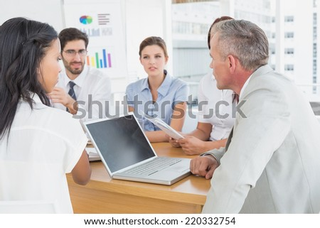 Business team discussing work details in a meeting - stock photo