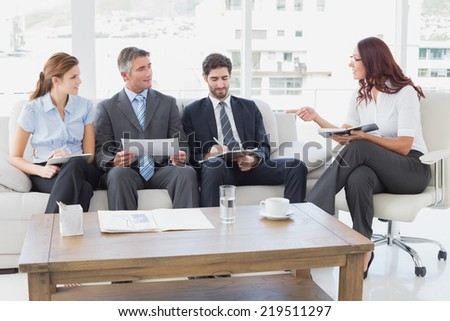 Business team discussing work notes in a meeting room