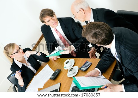 Business Team discussion various proposals - stock photo