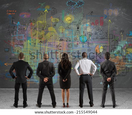 Business team drawing a new complex project - stock photo