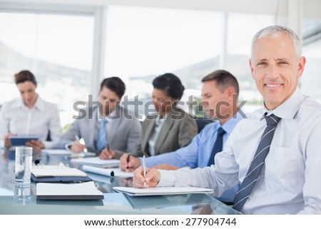 Business team during meeting in the office - stock photo