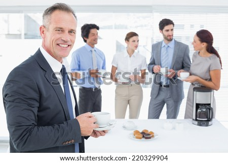 Business team enjoying some drinks at the office - stock photo