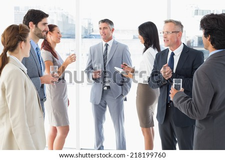 Business team enjoying some lunch at work - stock photo