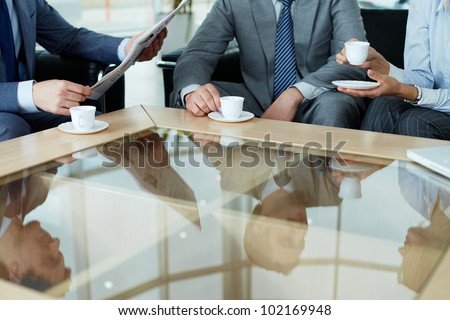 Business team having a break by cup of coffee - stock photo