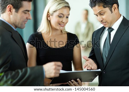 business team having informal meeting discussing a contract