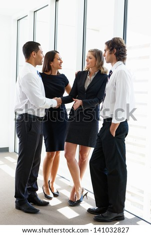 Business Team Having Informal Meeting In Office