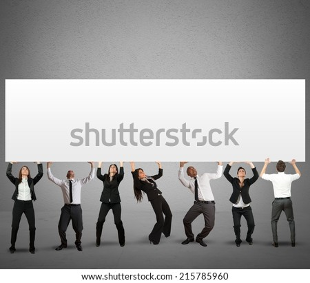 Business team holds a big banner for your message - stock photo