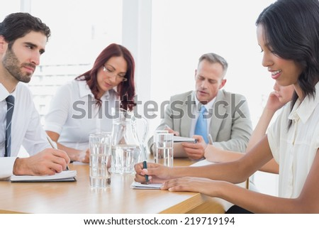 Business team in a meeting at work - stock photo