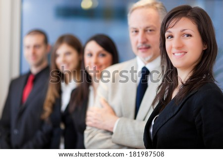 Business team in a modern office - stock photo