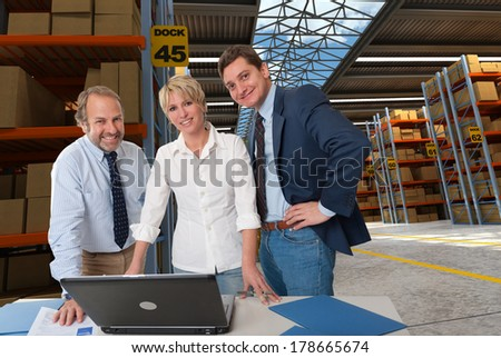 Business team in a transportation warehouse - stock photo