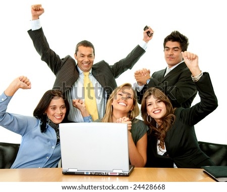 Business team in an office excited from their success - stock photo