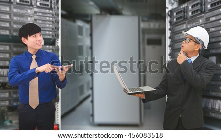 Business team in data center room - stock photo