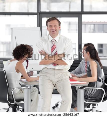 Business team led by Senior Businessman - stock photo
