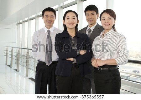 Business Team Looking At Camera