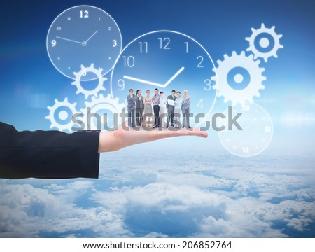 Business team looking at camera against blue sky over clouds at high altitude - stock photo