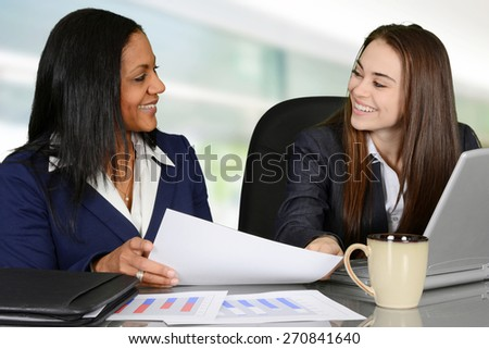 Business team looking at data charts and analyzing - stock photo