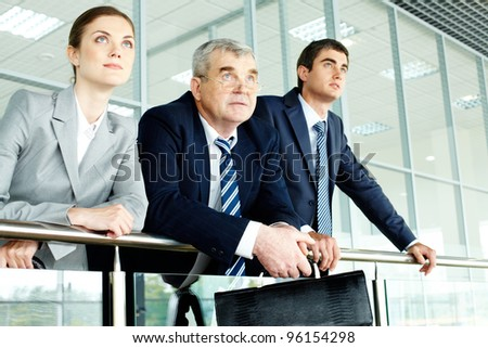 Business team looking confidently in future - stock photo